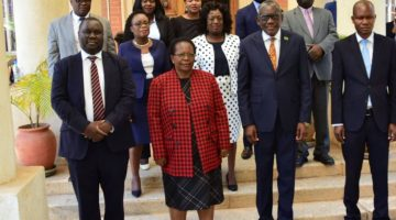 The Chief Justice and Minister of Local Government and Housing with members of the Rating Valuation Tribunal